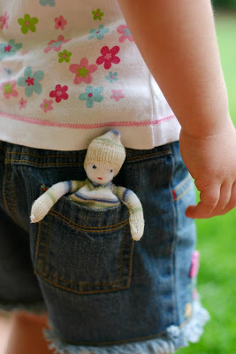 A doll for your pocket! This cuttie is fits into small hands and small pockets. Great for having in the car for a quick play and adventure.