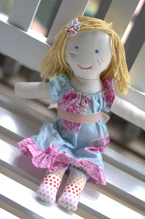 What a sweet doll. Her freckles! Simple yarn hair and elastic dress with a ruffle is perfect for any age. Make multiple clothes for her to change into.