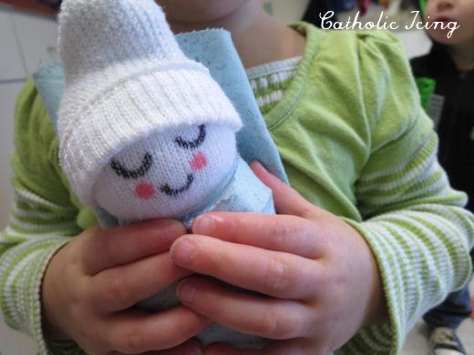 preschooler-loving-baby-jesus-sock-craft